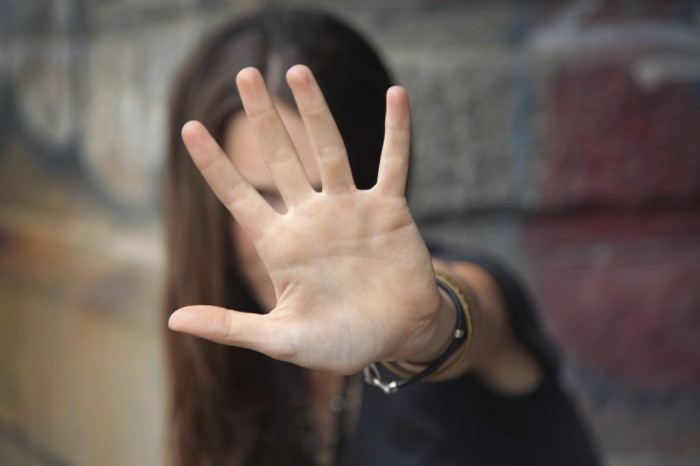 woman-with-hand-up-1024x683