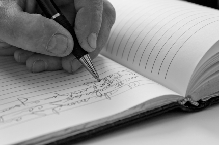 Man writing in a journal.